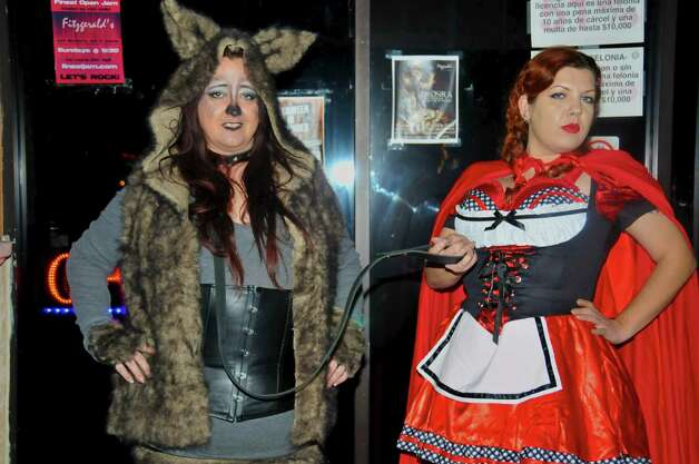 Tammy Defoe and Jessica Herman are enjoying a night of pre-Halloween dessing up at Fitzgerald's.