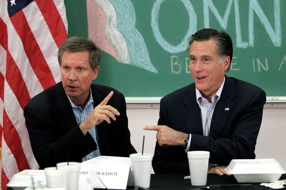 FILE - In this April 27, 2012 file photo, Republican presidential candidate, former Massachusetts Gov. Mitt Romney, right, and Ohio Gov. John Kasich participate in a roundtable discussion in Westerville, Ohio. Kasich is doing what he can to help Romney win the battleground state _ and that sometimes includes holding his tongue. Photo: AP