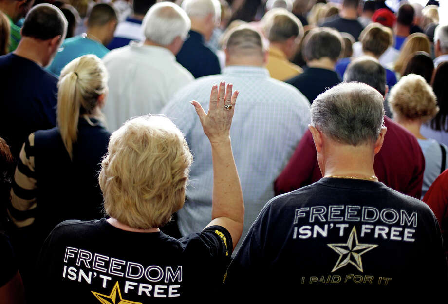 Supporters observe a moment of prayer before Republican presidential candidate, former Massachusetts Gov. Mitt Romney spoke at a campaign event at the Orlando Sanford International Airport, Monday, Nov. 5, 2012, in Sanford, Fla. Photo: AP