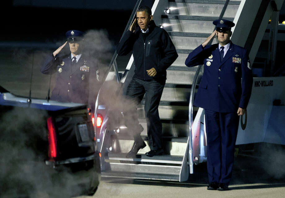 President Barack Obama salutes as he deplanes Air Force One on his early-morning arrival in Madison, Wis., Monday, Nov. 5, 2012. Photo: AP