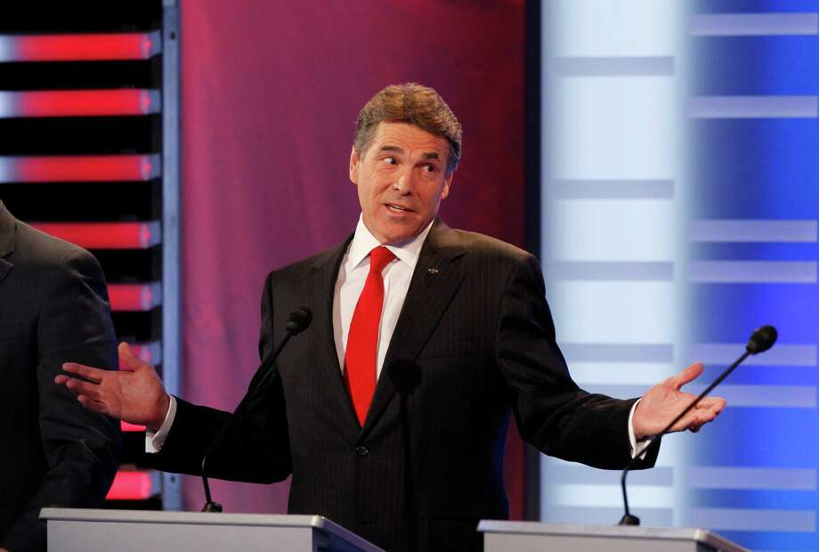 Rick Perry speaks during the GOP debate on the campus of Drake University on December 10, 2011 in Des Moines, Iowa. Photo: Pool, Getty / 2011 Getty Images