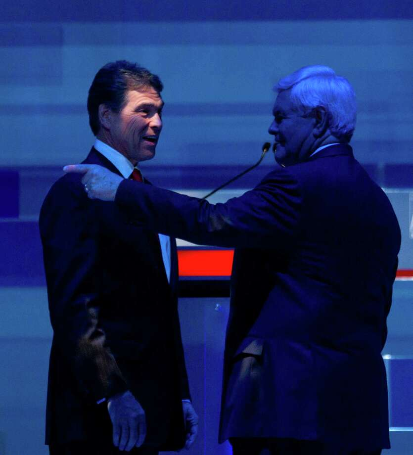 Rick Perry and Newt Gingrich speak during a commercial break in the South Carolina Republican presidential candidate debate Monday, Jan. 16, 2012, in Myrtle Beach, S.C. Photo: David Goldman, Associated Press / AP