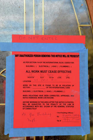 A cease work order is posted on the front door of a two-story home located at 33 Ponus Ave. in Stamford on Saturday, Nov. 3, 2012. A large tree crashed through the roof during Hurricane Sandy. Photo: Amy Mortensen / Connecticut Post Freelance