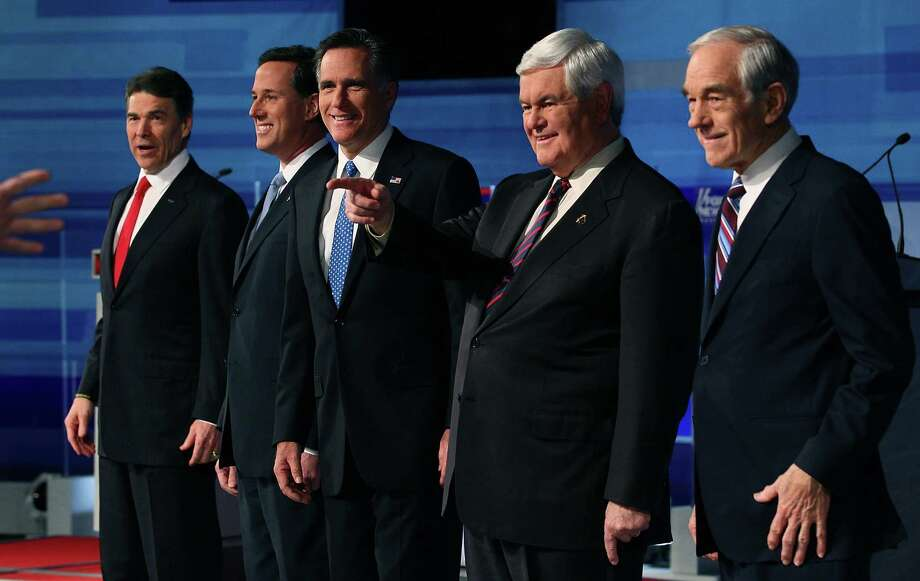 Rick Perry, Rick Santorum, Mitt Romney, Newt Gingrich, and Ron Paul pose for a photos before participating in a Fox News, Wall Street Journal sponsored debate at the Myrtle Beach Convention Center, on January 16, 2012 in Myrtle Beach, S.C. Photo: Mark Wilson, Getty Images / 2012 Getty Images