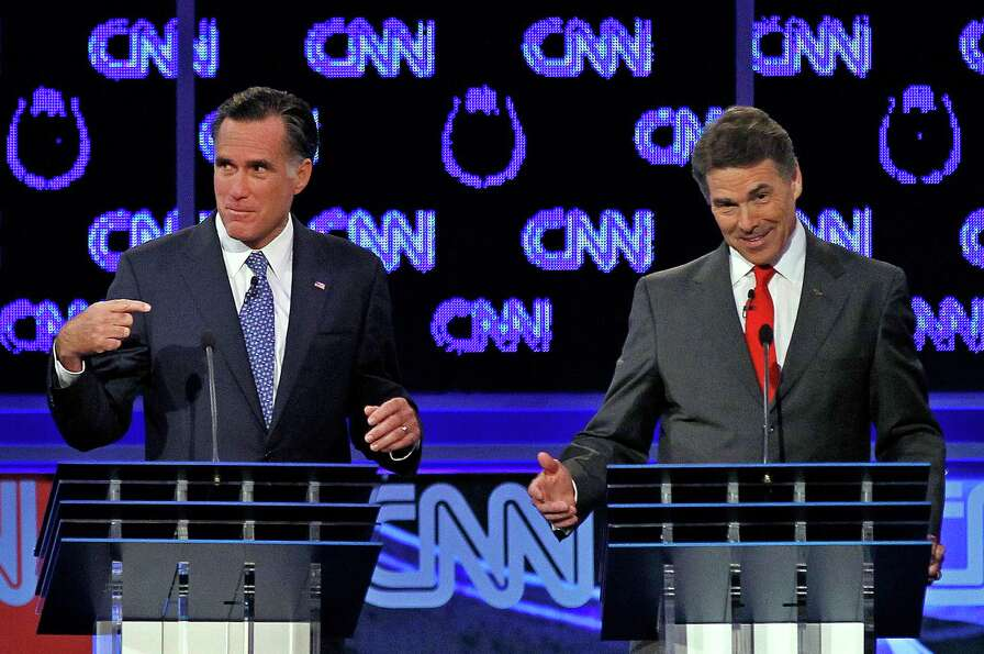 Mitt Romney and Rick Perry spar during a Republican presidential debate in Las Vegas.