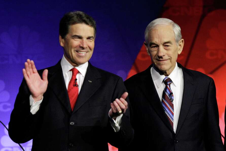 Rick Perry and Ron Paul, R-Texas are seen before a Republican presidential debate at Oakland Univers