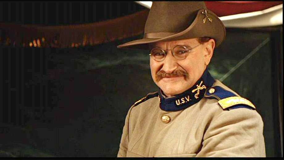 """Robin Williams as Theodore Roosevelt in """"Night at the Museum"""" (While he may be decked out in pre-White House Rough Rider garb, this Teddy comes to life in an exhibit of """"President"""" Roosevelt, and he's well aware of his executive accomplishments.)"""