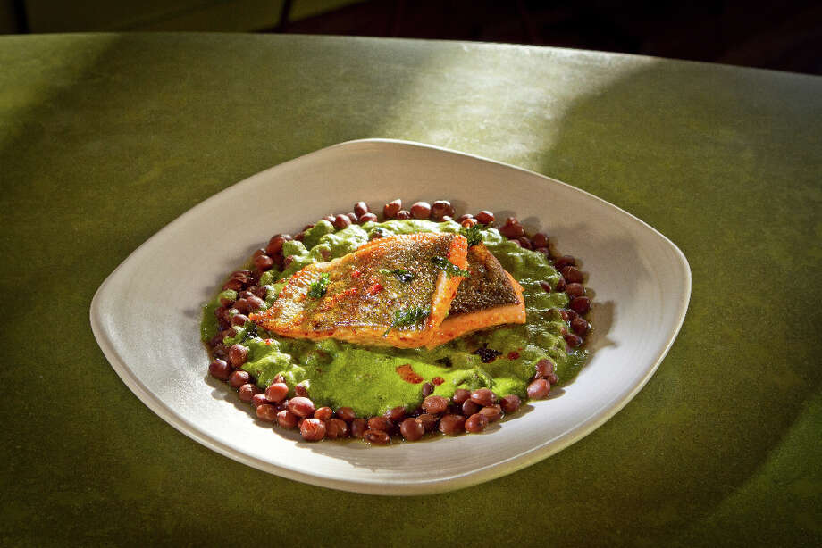 """There are also different dishes, including trout ($16.50) on a bed of pumpkin seed puree that also coats the Christmas lima beans underneath. The fish is supple, the beans fleshy and the sauce spicy from serrano chiles. A dynamic triad."" Photo: John Storey, Special To The Chronicle / John Storey"
