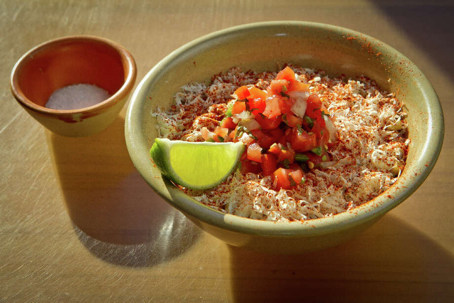 """Corn was on the menu in several guises. It was toasted to brown the kernels, then cut from the cob ($6) and enhanced with cotija cheese, cream and a kick of chile, lime and pico de gallo."" Photo: John Storey, Special To The Chronicle / John Storey"