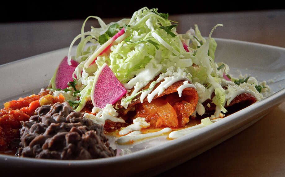"""Enchiladas ($14.50) consist of a tomato and jalapeno mash with crushed shrimp, a rich sauce of guajillo chile and a sprinkling of cabbage, shaved onions, black beans and pickled jalapeno to round out the complex flavor layers."" Photo: John Storey, Special To The Chronicle / John Storey"