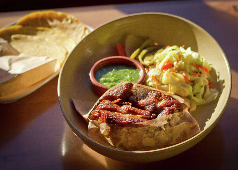 """And at both places I have to train myself to try something beyond the carnitas ($15.50), where the pork is subtly flavored with cinnamon, beer, orange and bay leaf, served with a cool and slightly spicy cabbage salad and tortillas so you can fold everything together and eat it like a soft taco."" Photo: John Storey, Special To The Chronicle / John Storey"