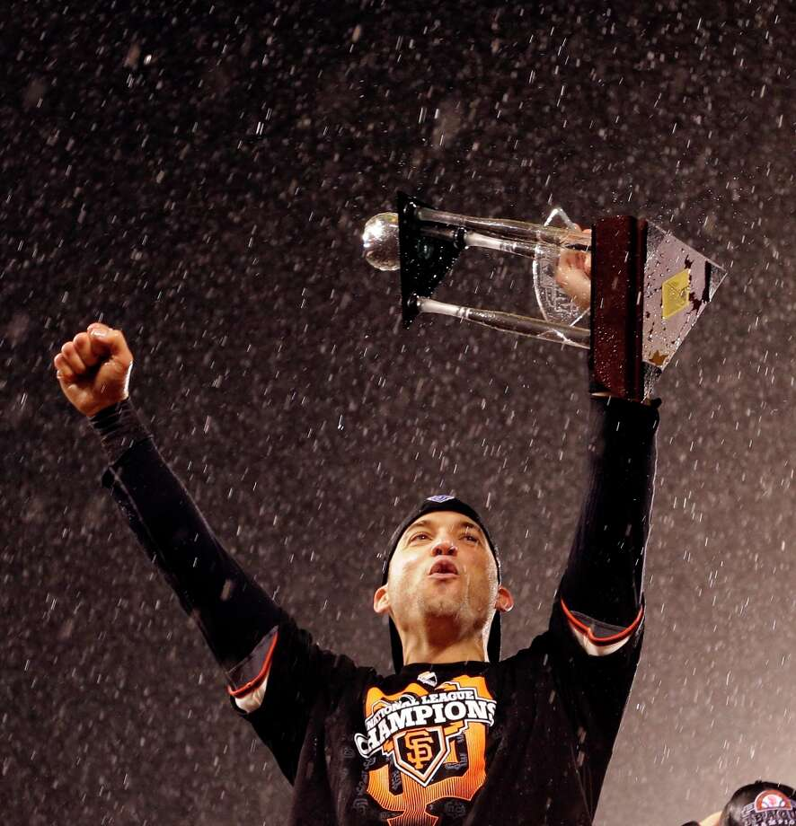 San Francisco Giants' Marco Scutaro celebrates after Game 7 of baseball's National League championship series against the St. Louis Cardinals Monday, Oct. 22, 2012, in San Francisco. The Giants won 9-0 to win the series. Scutaro was named the series MVP. Photo: David J. Phillip, Associated Press / AP
