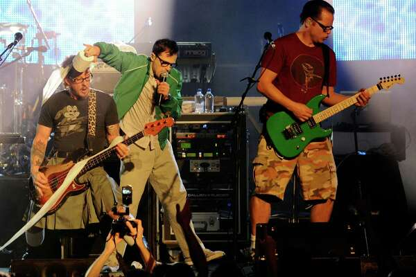 LAS VEGAS - OCTOBER 01:  (L-R) Weezer bassist Scott Shriner, frontman Rivers Cuomo and guitarist Patrick Wilson perform at the Bare Pool Lounge at the Mirage Hotel & Casino October 1, 2010 in Las Vegas, Nevada.