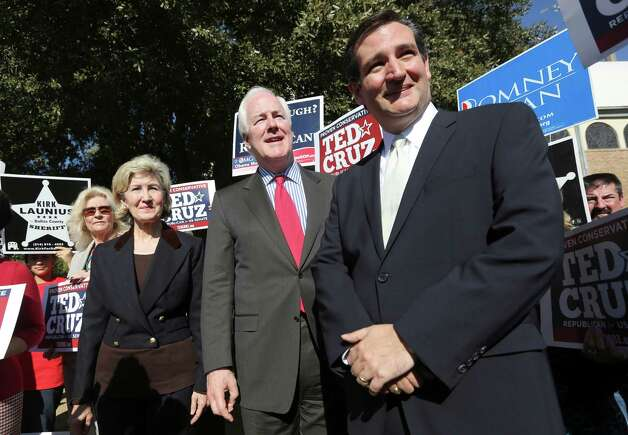 Republican candidate for U.S. Senate Ted Cruz, right, U.S. Senators Kay Bailey Hutchison, left, and John Cornyn listen to a question from reporters outside a polling station in Dallas, Thursday, Nov. 1, 2012. Cruz faces Democratic candidate Paul Sadler for the U.S. Senate seat vacated by fellow Republican Hutchison. (AP Photo/LM Otero) Photo: LM Otero, Associated Press / AP