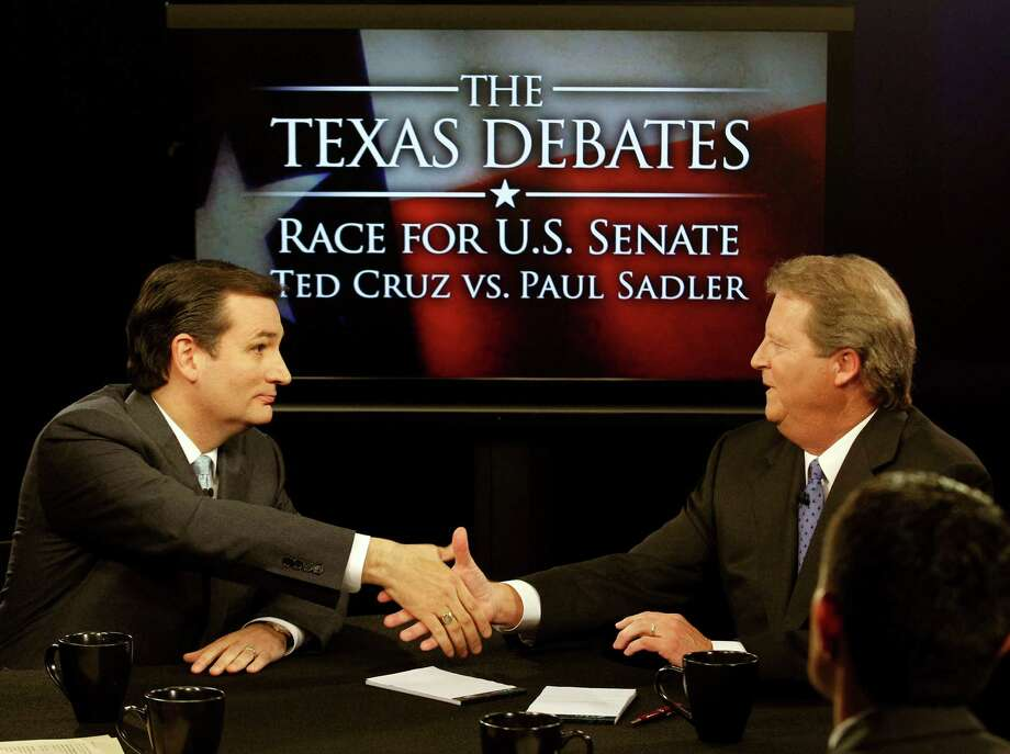 Republican candidate for U.S. Senate Ted Cruz, left, and Democratic candidate Paul Sadler shake hands at the close of their debate at  KERA television studious in Dallas, Friday, Oct. 19, 2012. The two Texas candidates are facing off for the open U.S. Senate seat. (AP Photo/LM Otero, Pool) Photo: LM Otero, Associated Press / Pool AP