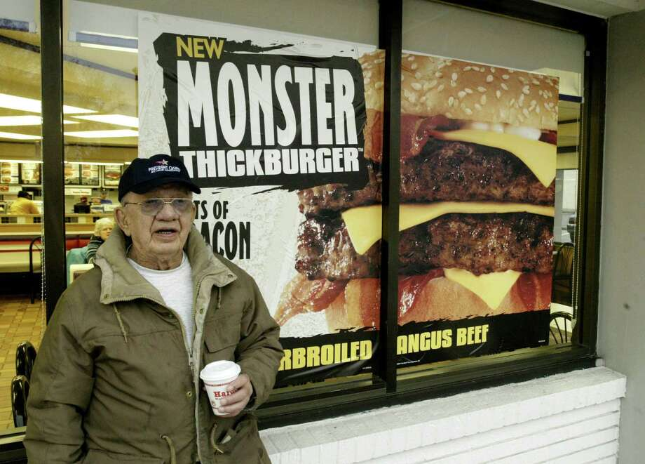 """Hardee's is home to the """"Monster Thickburger."""" You won't, however, be able to scare one up in Houston.  Photo: JAMES A. FINLEY, AP / AP"""