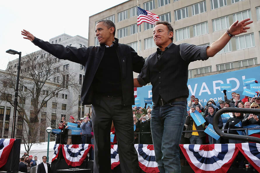 MADISON, WI - NOVEMBER 05:  U.S. President Barack Obama and rocker Bruce Springsteen wave to a cr