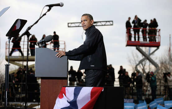 MADISON, WI - NOVEMBER 05:  U.S. President Barack Obama addresses a rally during the last day of campaigning in the general election November 5, 2012 in Madison, Wisconsin. Obama and his opponent, Republican presidential nominee and former Massachusetts Gov. Mitt Romney are stumping from one 'swing state' to the next in a last-minute rush to persuade undecided voters. Photo: Chip Somodevilla, Getty Images / 2012 Getty Images