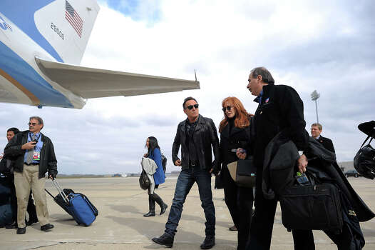 Singer Bruce Springsteen (C) and his wife Patti Scialfa chat with David Axelrod, US President Brack Obama's senior campaign startegist, as they board Air Force One before Obama leaves Madison, Wisconsin, on November 5, 2012. After a grueling 18-month battle, the final US campaign day arrived for Obama and Republican rival Mitt Romney, two men on a collision course for the world's top job. The candidates have attended hundreds of rallies, fundraisers and town halls, spent literally billions on attack ads, ground games, and get out the vote efforts, and squared off in three intense debates.    AFP PHOTO/Jewel Samad Photo: JEWEL SAMAD, AFP/Getty Images / 2012 AFP