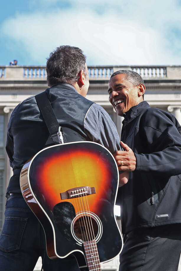 MADISON, WI - NOVEMBER 05:  Rocker Bruce Springsteen (L) welcomes U.S. President Barack Obama to the stage during a rally on the last day of campaigning in the general election November 5, 2012 in Madison, Wisconsin. Obama and his opponent, Republican presidential nominee and former Massachusetts Gov. Mitt Romney are stumping from one 'swing state' to the next in a last-minute rush to persuade undecided voters. Photo: Chip Somodevilla, Getty Images / 2012 Getty Images