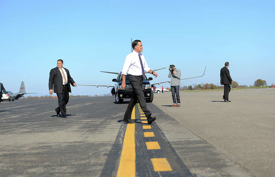 US Republican Presidential candidate Mitt Romney walks towards his campaign plane after a rally at Lynchburg regional airport in Lynchburg, Virginia, on November 5, 2012. After a grueling 18-month battle, the final US campaign day arrived for President Barack Obama and Republican rival Mitt Romney, two men on a collision course for the world's top job. The candidates have attended hundreds of rallies, fundraisers and town halls, spent literally billions on attack ads, ground games, and get out the vote efforts, and squared off in three intense debates.   AFP PHOTO/Emmanuel DUNAND Photo: EMMANUEL DUNAND, AFP/Getty Images / 2012 AFP