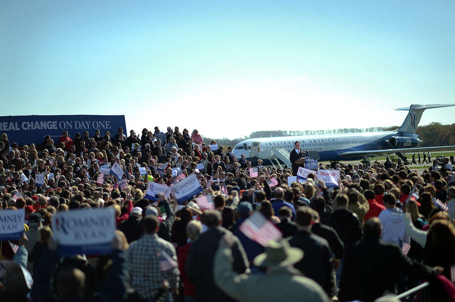US Republican presidential candidate Mitt Romney holds a rally at Lynchburg regional airport in Lynchburg, Virginia, on November 5, 2012. After a grueling 18-month battle, the final US campaign day arrived for President Barack Obama and Republican rival Mitt Romney, two men on a collision course for the world's top job. The candidates have attended hundreds of rallies, fundraisers and town halls, spent literally billions on attack ads, ground games, and get out the vote efforts, and squared off in three intense debates.    AFP PHOTO/Emmanuel DUNAND Photo: EMMANUEL DUNAND, AFP/Getty Images / 2012 AFP