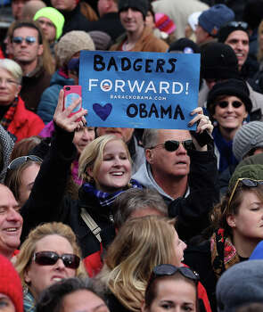 MADISON, WI - NOVEMBER 05:  18,000 people fill the streets in front of the state capitol building to hear U.S. President Barack Obama address a rally during the last day of campaigning in the general election November 5, 2012 in Madison, Wisconsin. Obama and his opponent, Republican presidential nominee and former Massachusetts Gov. Mitt Romney are stumping from one 'swing state' to the next in a last-minute rush to persuade undecided voters. Photo: Chip Somodevilla, Getty Images / 2012 Getty Images