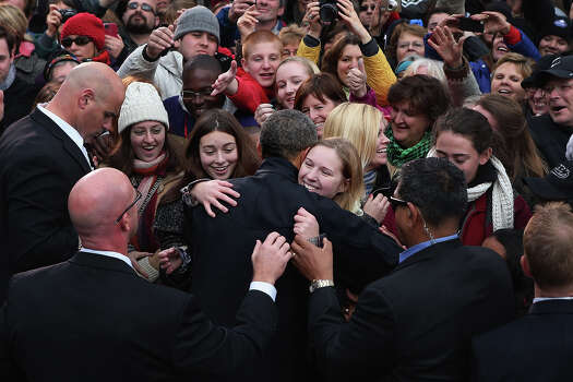 MADISON, WI - NOVEMBER 05:  U.S. President Barack Obama embraces some of the 18,000 supporters during a rally on the last day of campaigning in the general election November 5, 2012 in Madison, Wisconsin. Obama and his opponent, Republican presidential nominee and former Massachusetts Gov. Mitt Romney are stumping from one 'swing state' to the next in a last-minute rush to persuade undecided voters. Photo: Chip Somodevilla, Getty Images / 2012 Getty Images