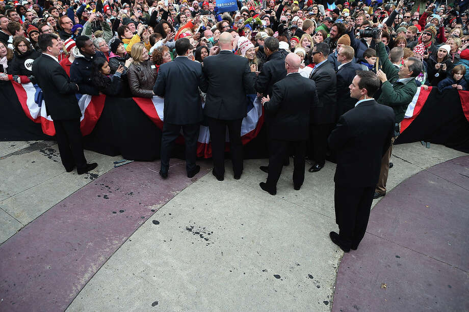 MADISON, WI - NOVEMBER 05:  Secret Service agents surround U.S. President Barack Obama as he greets some of the 18,000 supporters during a rally on the last day of campaigning in the general election November 5, 2012 in Madison, Wisconsin. Obama and his opponent, Republican presidential nominee and former Massachusetts Gov. Mitt Romney are stumping from one 'swing state' to the next in a last-minute rush to persuade undecided voters. Photo: Chip Somodevilla, Getty Images / 2012 Getty Images