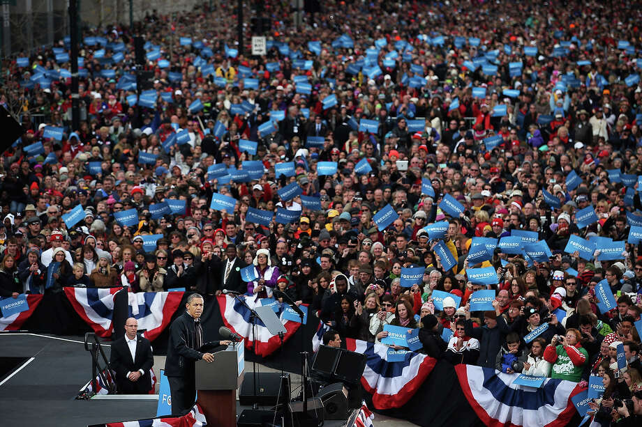 MADISON, WI - NOVEMBER 05:  U.S. President Barack Obama addresses an audience of 18,000 during a rally on the last day of campaigning in the general election November 5, 2012 in Madison, Wisconsin. Obama and his opponent, Republican presidential nominee and former Massachusetts Gov. Mitt Romney are stumping from one 'swing state' to the next in a last-minute rush to persuade undecided voters. Photo: Chip Somodevilla, Getty Images / 2012 Getty Images