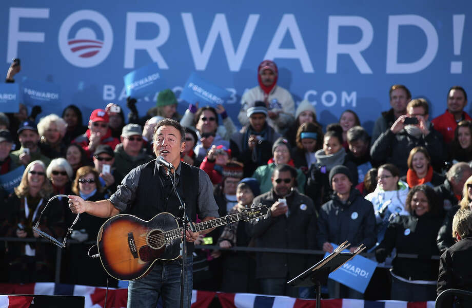 MADISON, WI - NOVEMBER 05:  Rocker Bruce Springsteen performs during a rally for President Barack Obama on the last day of campaigning in the general election November 5, 2012 in Madison, Wisconsin. Obama and his opponent, Republican presidential nominee and former Massachusetts Gov. Mitt Romney are stumping from one 'swing state' to the next in a last-minute rush to persuade undecided voters. Photo: Chip Somodevilla, Getty Images / 2012 Getty Images