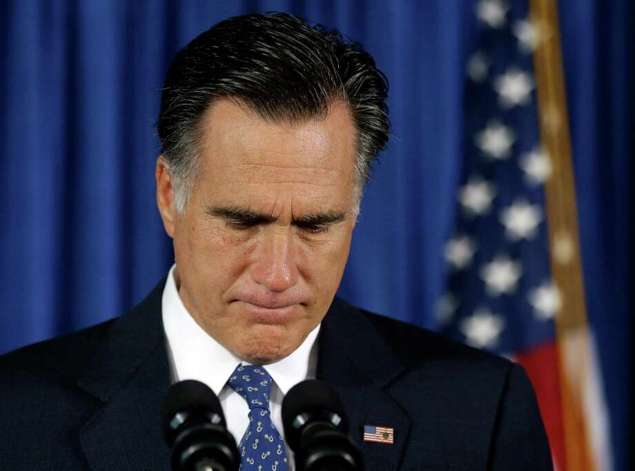 In this Sept. 12, 2012, file photo, Republican presidential candidate, former Massachusetts Gov. Mitt Romney makes comments on the killing of U.S. embassy officials in Benghazi, Libya, while speaking in Jacksonville, Fla. With protests at U.S. embassies and four Americans dead, Romney is suddenly facing a presidential election focused on a foreign policy crisis he gambled wouldn't happen. But it did happen _ and at a bad time. Momentum in the race is on President Barack Obama's side and Republicans are fretting over the state of their nominee's campaign. (AP Photo/Charles Dharapak) Photo: Charles Dharapak, Associated Press / AP
