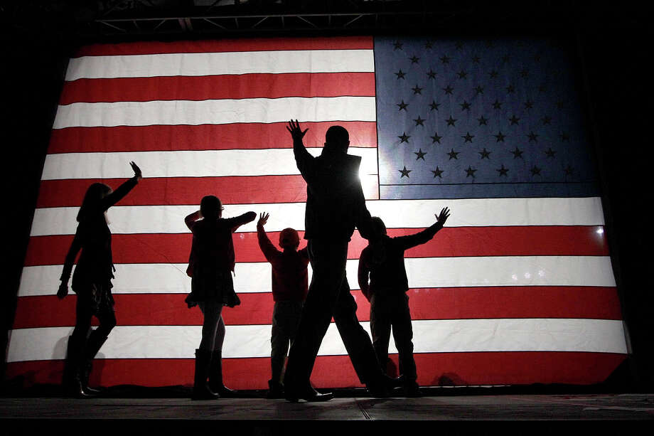Republican vice presidential candidate, Rep. Paul Ryan, R-Wis., waves as he comes off the stage with his wife Janna, left, daughter Liza, second from left, and sons Sam and Charlie, right, during a campaign event, Monday, Nov. 5, 2012 in Reno, Nev. Photo: AP