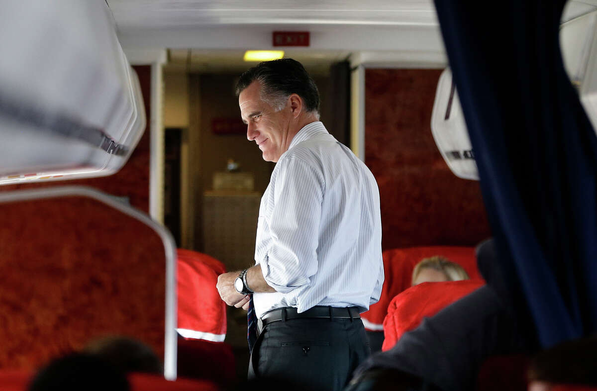 Republican presidential candidate, former Massachusetts Gov. Mitt Romney walks on his plane as it flies to Washington Dulles Airport for a Virginia campaign rally at The Patriot Center, George Mason University, in Fairfax, Va., Monday, Nov. 5, 2012.