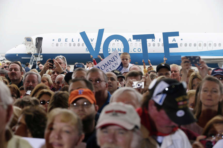 Supporters listen as Republican presidential candidate and former Massachusetts Gov. Mitt Romney speaks at a Florida campaign rally at Orlando Sanford International Airport, in Sanford, Fla., Monday, Nov. 5, 2012. Photo: AP