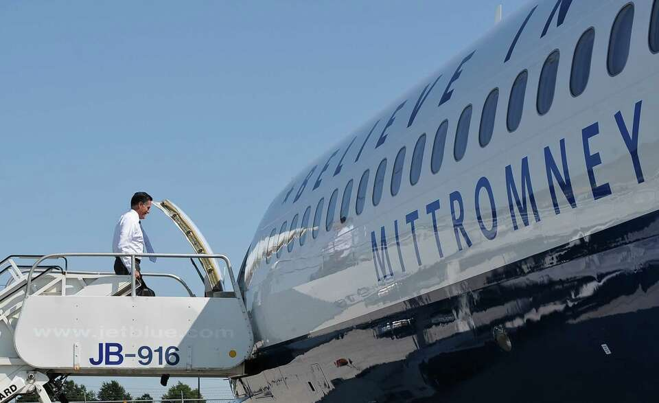 US Republican presidential candidate Mitt Romney boards his plane at Dulles International Airport in