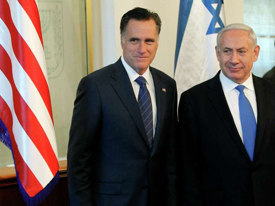 """FILE - In this July 29, 2012 file photo, Republican presidential candidate, former Massachusetts Gov. Mitt Romney meets with Israel's Prime Minister Benjamin Netanyahu in Jerusalem. Romney is criticizing President Barack Obama for not planning to meet in person with Netanyahu next week, calling it """"confusing and troubling.""""  Romney said at a New York fundraiser Friday that Israel is America's """"closest ally"""" and """"best friend in the Middle East."""" He urged Obama to meet with Netanyahu surrounding the start of United Nations General Assembly meetings next week.  (AP Photo/Charles Dharapak, File) Photo: Charles Dharapak, Associated Press / AP"""