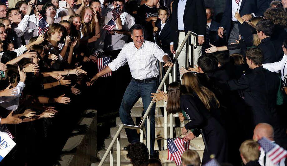 In this Sept. 23, 2012 file photo, Mitt Romney greets the crowd during a campaign event at D'Evelyn High School in Denver. Photo: AP