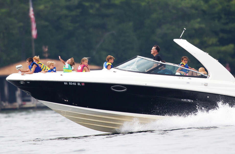 In this July 14, 2012 file photo, Mitt Romney takes his family for a boat ride on Lake Winnipesaukee in Wolfeboro, N.H. Photo: AP