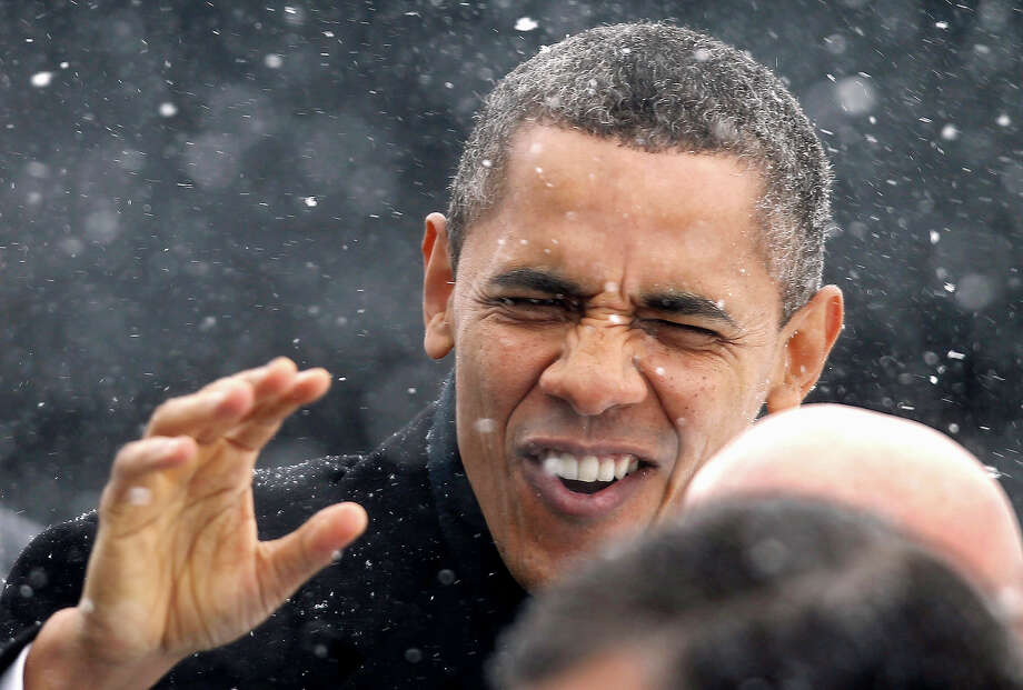 In this March 1, 2012 file photo, President Obama waves to the crowd as he walks through a snowstorm after getting off Air Force One in Manchester, N.H. Photo: AP