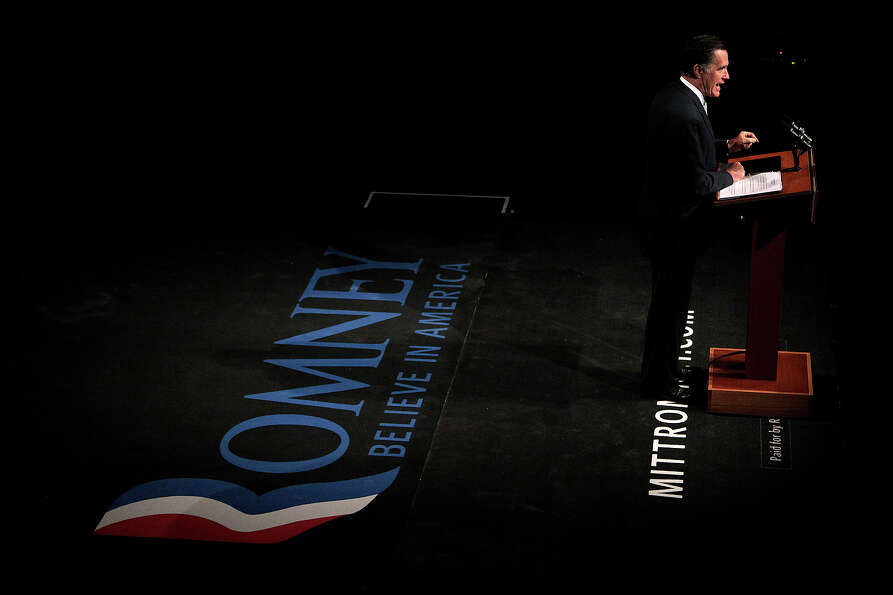 In this May 8, 2012 file photo, Mitt Romney speaks at a campaign stop in Lansing, Mich.