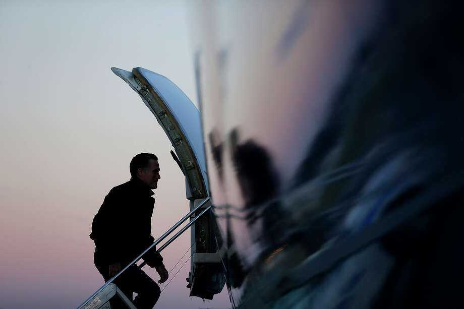 In this Nov. 2, 2012 file photo, Mitt Romney boards his plane in Norfolk, Va., as he travels to campaign events in Milwaukee. Photo: AP
