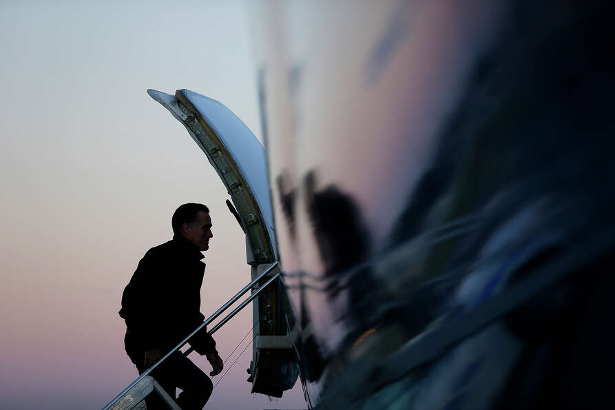 In this Nov. 2, 2012 file photo, Mitt Romney boards his plane in Norfolk, Va., as he travels to camp