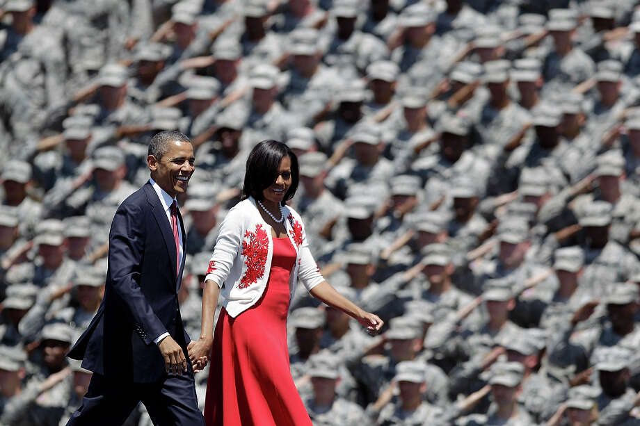 In this April 27, 2012 file photo, President Obama and first lady Michelle Obama are saluted by soldiers as they arrive at the Fort Stewart Army post in Fort Stewart, Ga. Photo: AP