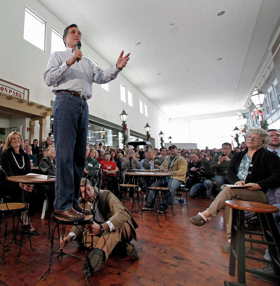 In this Dec. 29, 2011 file photo, Mitt Romney speaks during a campaign stop at the Music Man Square in Mason City, Iowa. Photo: AP