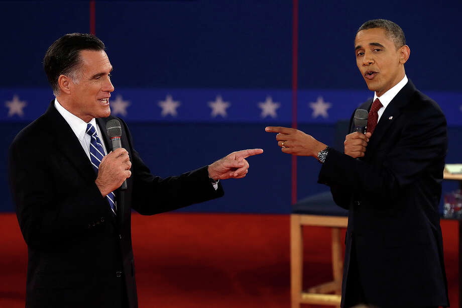 In this Oct. 16, 2012 file photo, Republican presidential candidate, former Massachusetts Gov. Mitt Romney and President Barack Obama spar during the second presidential debate at Hofstra University in Hempstead, N.Y. Photo: AP