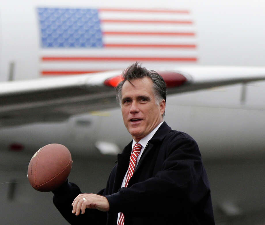 In this Oct. 26, 2012 file photo, Mitt Romney prepares to throw a football on the tarmac of Akron-Canton Regional Airport in Akron, Ohio. Photo: AP