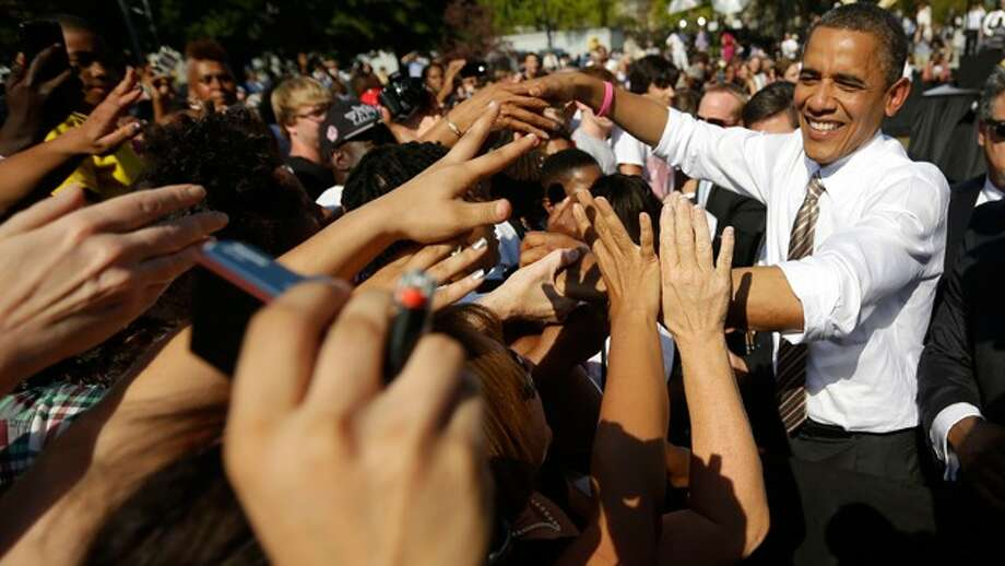 President Obama greets supporters after speaking at a campaign event at the Carillon at Byrd Park, Oct. 25, 2012, in Richmond. (Pablo Martinez Monsivais / AP Photo)