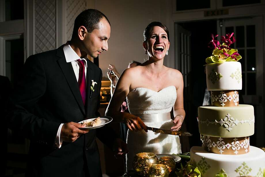 Sanjeev Ramakumar and Megan Kamil cut their wedding cake in October at the Kohl Mansion in Burlingame. Photo: Anna Kuperberg