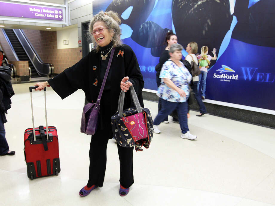 Maraleen Manos-Jones arrives with a wayward Monarch female butterfly, (inside the Igloo carry on), at the San Antonio International Airport, Monday, Nov. 5, 2012. Manos-Jones first found the lone specimen late September in her butterfly garden near Albany, New York. Southwest Airlines donated the ticket that allowed Manos-Jones to bring the butterfly to San Antonio, allowing it to catch up with migrating Monarch on their way to breeding grounds in Michoacan, Mexico. Photo: Jerry Lara, San Antonio Express-News / © 2012 San Antonio Express-News